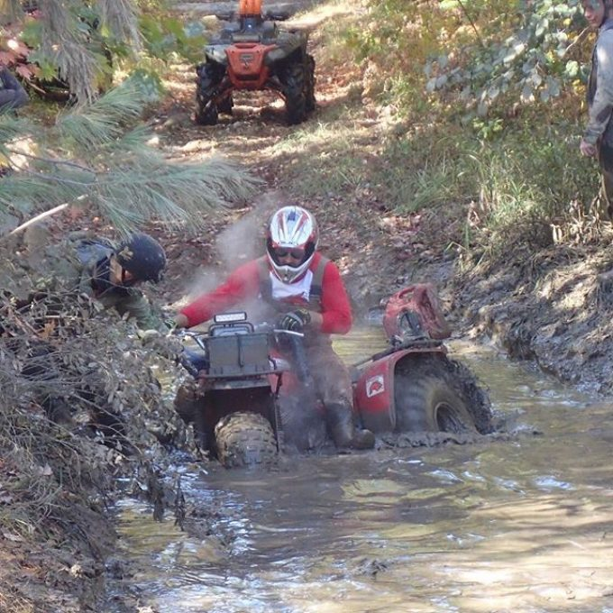 Going through some deep mud with BigRed. #swampdonkeys