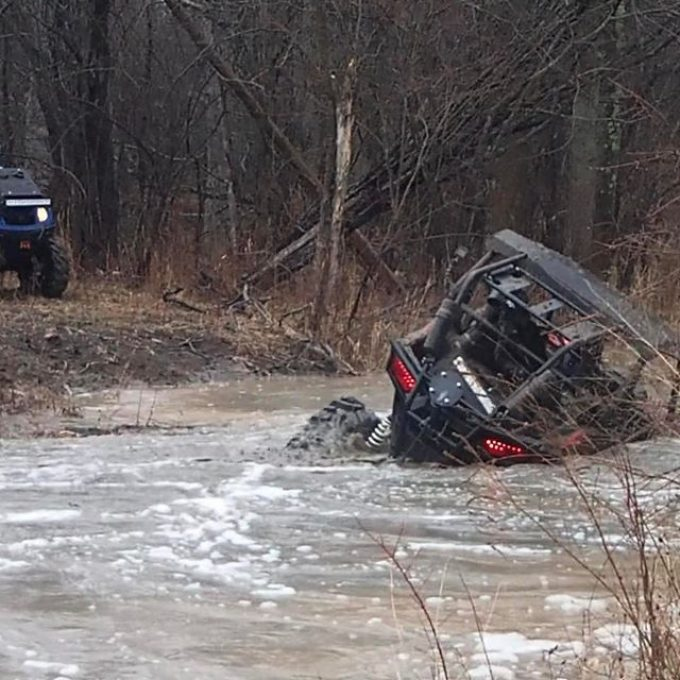 #swampdonkeys @swampdonkeygrizz found a little bump in the #river on his #polaris #rzr