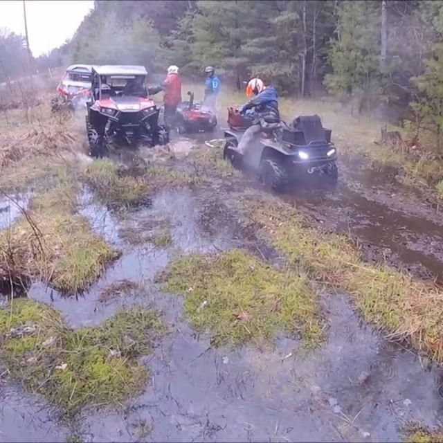 #polaris #rzr and #canam #MaverickXMR passing the boys stuck on a stump. #arcticcat #broke an #axle #swampdonkeys
