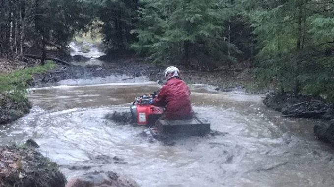 @chriscross4653 leading the #swampdonkeys through the trails in #Muskoka #Honda #water #mud #rain